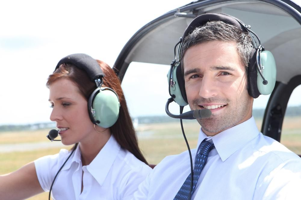 Man and woman in the cockpit of a light aircraft